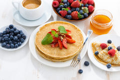 Crepes with strawberries and honey for breakfast Stock Photos