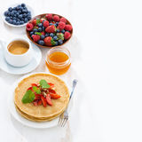 Crepes with strawberries and honey for breakfast Royalty Free Stock Images