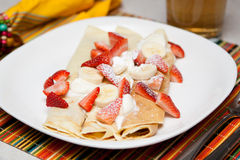 Crepes with strawberry, banana and whip cream Stock Images