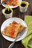Crepes with strawberry sauce Stock Image