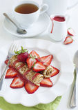 Crepes with strawberry and strawberry sauce Stock Image