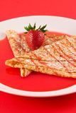 Crepes with strawberry syrup Royalty Free Stock Photos