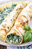 Crepes stuffed with cheese and spinach Stock Image