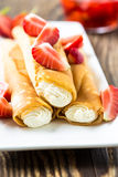 Crepes stuffed with cheese and strawberry topping Royalty Free Stock Image