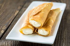 Crepes stuffed with cheese Royalty Free Stock Photos