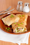 Crepes stuffed with meat and vegetables. Close up vertical Stock Photos