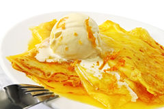 Crepes Suzette. With rich vanilla ice cream. Zesty sweet orange sauce royalty free stock photos