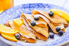Crepes suzette with berries breakfast plate. Stock Images