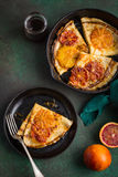 Crepes suzette, delicious pancakes with orange sauce Stock Images