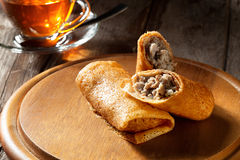 Crepes. View of nice fresh hot crepes with grounded  meat  on color background Stock Photography