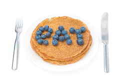 Crepes and the words of fresh blueberries isolated on white Stock Photos