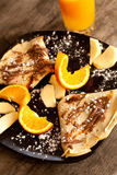 Crepes y naranjas Imagen de archivo