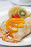 Creps with fruits. Two delicious creps with fruits and syrup Royalty Free Stock Image