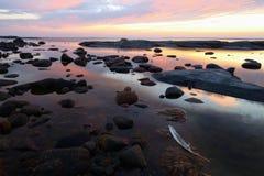 Crepúsculo del archipiélago de la pluma blanca Fotos de archivo libres de regalías