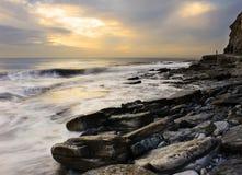 Crepuscolo della baia di Dunraven Immagini Stock