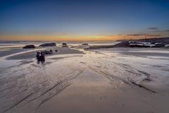 Crepuscolo sopra la spiaggia portoghese fotografie stock