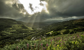 Crepuscular Rays over the Rhondda. Beams of crepuscular light shine down on the Rhondda valley near Trehafod Stock Images