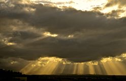 CrepuscularRays. An awesome display of sunlight radiating through the gaps of clouds showing columns of sunlit air. Also known as Angel lights, God rays, sun Stock Photo