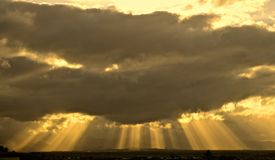 CrepuscularRays. An awesome display of sunlight radiating through the gaps of clouds showing columns of sunlit air. Also known as Angel lights, God rays, sun Royalty Free Stock Photo