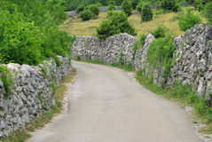 Cres dry stone wall and way. Island Cres in Croatia, dry stone wall and road Royalty Free Stock Images