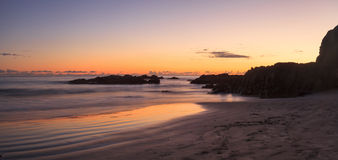 Crescent Bay beach at sunset Stock Images