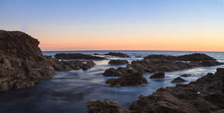 Crescent Bay beach at sunset Royalty Free Stock Image