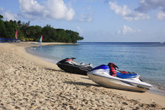Crescent Beach in the Caribbean. Paynes Bay beach in Barbados with jet skis in the foreground Royalty Free Stock Image
