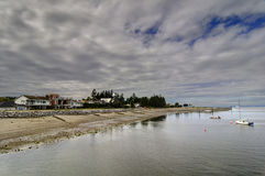 Crescent beach on a cloudy day Stock Image