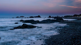 Crescent city beach in the early morning. Beach in Crescent City, California, USA, during a low tide, in the early morning, near the Battery Point Lighthouse Stock Images