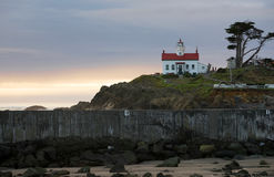Crescent City California Pacific Coast Battery Point Lighthouse. Night falls on a rocky outcropping in Crescent City Stock Image