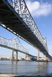 Crescent City Connection Bridges. Vertical shot of the twin spans of the Crescent City Connection bridges in New Orleans as the cross the port Royalty Free Stock Image