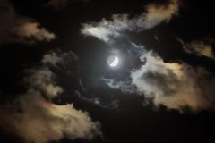 Crescent in the dark cloudy sky. This photo was taken on Portuguese island of Madeira stock photography