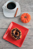 Crescent dough nut Chocolate frosted dough nut with mug of pumpkin spice coffee Stock Photos