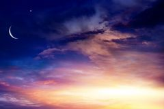 Light from sky . Religion background . Crescent moon with beautiful sunset background . Generous Ramadan . Light from sky . Religion background royalty free stock photos