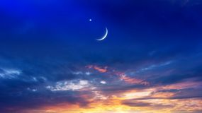 Generous Ramadan . Light from sky . Religion background . Crescent moon with beautiful sunset background . Generous Ramadan . Light from sky . Religion royalty free stock photos