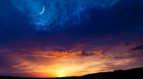 Light from sky . Religion background . Crescent moon with beautiful sunset background . Generous Ramadan . Light from sky . Religion background .Crescent moon stock image