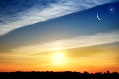 Light from sky . Religion background . Crescent moon with beautiful sunset background . Generous Ramadan . New moon. Prayer time royalty free stock photos