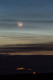 Crescent moon. On the city Royalty Free Stock Photos