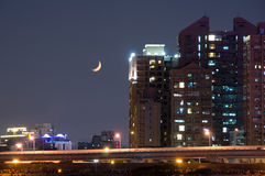 Crescent moon and city Royalty Free Stock Image