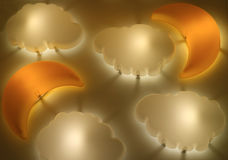 Crescent Moon and Cloud Shaped Lamps Shining on the Wall Royalty Free Stock Image