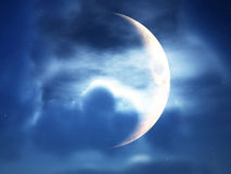 Crescent Moon Through Clouds. A crescent moon in a cloudy night time sky Stock Photos