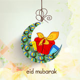 Crescent moon with gifts for Eid celebration. Royalty Free Stock Photo