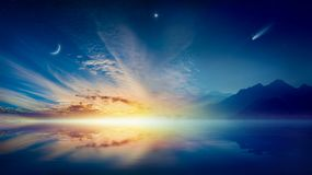 Crescent moon, glowing clouds, bright star and comet above serene sea. Amazing surreal background - crescent moon, glowing clouds, bright star and comet above stock images
