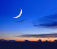 Crescent moon in the night Stock Images