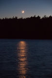 Crescent Moon Over Lake Stock Image