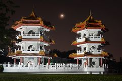 Crescent moon rising between the Twin Pagodas at the Chinese Garden in Singapore stock photo