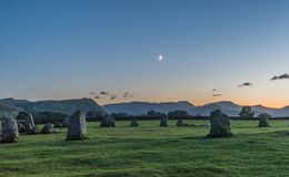 Crescent moon setting over the stone circle stock photos
