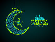 Crescent moon, star and Arabic text for Eid. Stock Image