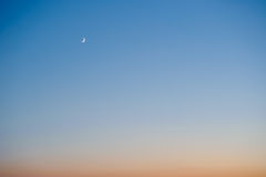 Crescent moon at sunset Royalty Free Stock Photography