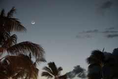Crescent Moon in the Sunset Stock Photo
